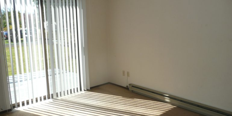 732 W 6th St master bedroom with sliding glass doors to back yard deck